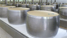 Photograph of the cheese in the steel moulds